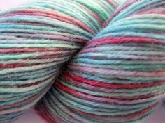 """(sock) Sock Yarn """"A Certain Alien"""" - Hand Dyed Yarn in teal, aqua, red, pink by Spacefrog Yarns on Etsy"""