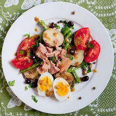 Salad Nicoise - a french dish of tuna, boiled eggs, potato, green beans, olives, fresh tomato and vinaigrette. So good!