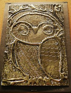 3D metallic art: draw image on cardboard with glue, press foil over it, etch detail with pencil, highlight with shoe polish.  (I saw a suggestion to use a coloring book page for the design, too.)