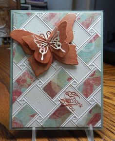 handmade thank-you card ... large layered butterfly ... embossing folder with rectangular tiles ... patterned paper  covers the tiles diagonally in one direction ... the other left white ... looks like a weaving desing ... like this card!!