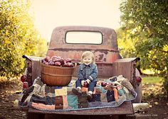 I love the location, lighting, props and colors in this photo. BEAUTIFUL! I can see my family in the back of a truck like that for our pictures!