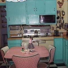 Love the teal cabinets and pink table and chairs