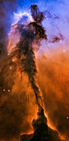 Stellar Spire In The Eagle Nebula  Image Credits: Credit: NASA, ESA, and The Hubble Heritage Team (STScI/AURA)  Retouching by Marco Oliveira   Appearing like a winged fairy-tale creature poised on a pedestal, this object is actually a billowing tower of cold gas and dust rising from a stellar nursery called the Eagle Nebula. The soaring tower is 9.5 light-years or about 57 trillion miles high, about twice the distance from our Sun to the next nearest star.