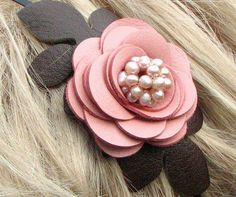 Flower leather headband fascinator, honeysuckle pink rose, moss green leaves, freshwater pearl center on skinny metal hairband. By Leather Blossoms.
