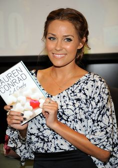 Lauren Conrad Braided Bun.  Lauren Conrad has left a few strands loose from her two french braids pulled back into a bun to soften the look.