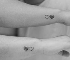 Three hearts shaded to correspond to birth order? I think I would shade in a color