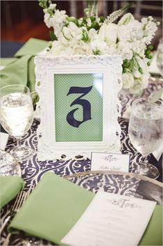 white green and navy table decor and number ideas #weddingreception #tabledecor #weddingchicks http://www.weddingchicks.com/2014/04/02/navy-and-green-southern-wedding/