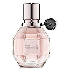 Viktor & Rolf Flowerbomb - my husband got me a huge bottle of this a couple of years ago and I've barely made a dent in it. I should wear it more often. It smells like sex and candy.