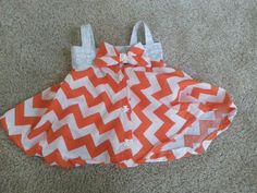 Orange Chevron pattern dress for 10-month old girl.