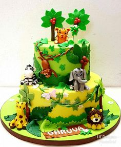 Jungle cake for Dhruva's How cute are these animals? Cake Flavor : A Be. - Torten - first birthday cake-Erster Geburtstagskuchen Jungle Birthday Cakes, Jungle Theme Cakes, Baby Boy Birthday Cake, Boys 1st Birthday Cake, Animal Birthday Cakes, Birthday Cake Flavors, Safari Cakes, Safari Theme, Animal Cakes For Kids