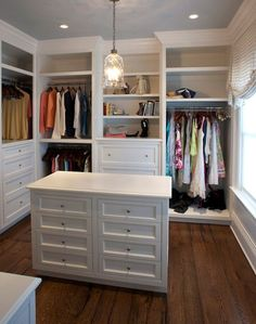 Gorgeous walk-in closet with custom shelving and clothes rails over built-in dresser drawers surrounding a white closet island. Master Closet Design, Walk In Closet Design, Master Bedroom Closet, Closet Designs, Master Closet Layout, Bathroom Closet, Master Bedrooms, Closet Rooms, Bedroom Closets