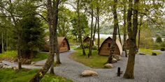 Wooden wigwams dotted around woodland near the banks of Loch Tay, Perthshire.