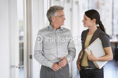 Foto de stock : Business man and female colleague talking in office