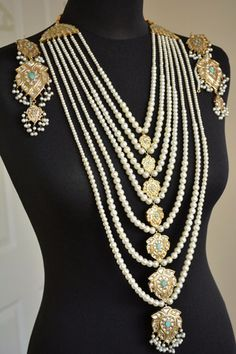 gold plated rani haar set in semi precious stones.