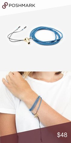 """Azure Wrap Bracelet/Necklace Fashion With a Cause // For every product you purchase, YOU provide 7 meals to a child in need!   A new look, Amelie bracelet is a beautifully simplistic wrap bracelet is an automatic favorite that you are sure to fall in love with. P.S. For added fun, try wearing it as a necklace!   -32"""" adjustable wrap bracelet  -handmade seed bead patter  -gold plated 22mm bullet casing  -handmade in Haiti.   No trades. Ships daily Mon to Fri. Add to Bundle to save or just…"""