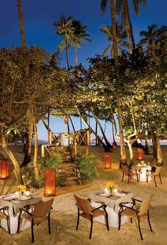 Outdoor dining, by the sea. Jungle Restaurant,  La Romana.  THE DOMINICAN REPUBLIC.