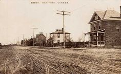 Manitoba -Postcard with concrete house on right.This two-storey residence in the village of Arden, in the Rural Municipality of Lansdowne, was built in 1905, probably by the Arden Cement Block and Building Company established in 1904