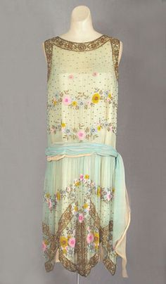 This reminds me of A Hope Undaunted  French beaded silk chiffon dress c.1924, from the Vintage Textile archives.