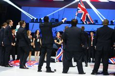 Team UK assemble on stage for their team song