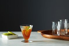 Rum Punch 2 cups rum 2 cups strong black tea 1/2 cup demerara sugar 1/2 cup lime juice Spices of your choice (see below)