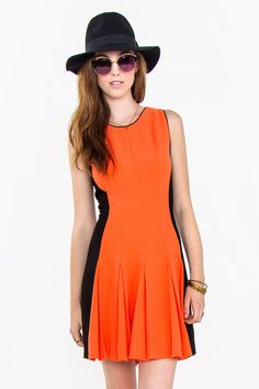 GAME WINNER DRESS Bright, light, trendy and stylish Spring/Summer dress. Fresh orange color and black colorblock drop waist . Pair it with black boots and a leather jacket to complete the look.