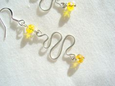 A bright and cheerful colour :)  Swarovski Earrings Canary Yellow Swirly Curly by tigger2day, $16.95