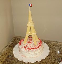 Eiffel Tower made from wafer cookies. (upside down waffle cone could work)