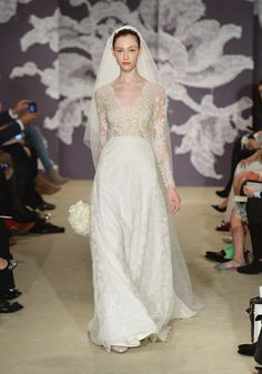 An Ivory deep V-neck lace gown with long sleeves from the Carolina Herrera spring 2015 bridal collection.