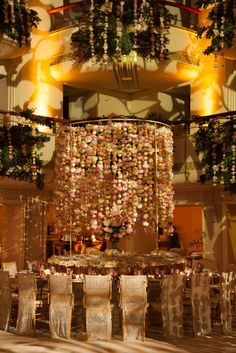 Wedding in NYC by SBK Event Design featuring hanging floral centerpiece.