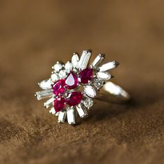 Ring - Five pear-drop rubies surrounded by marquise, straight baguette and round brilliant cut diamonds, all in a platinum setting.  Modern jewellery, jewelry.