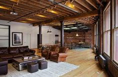 Gorgeous interior pairing woods with exposed brick.  LOVE.  Franklin Street Loft-01-1 Kind Design