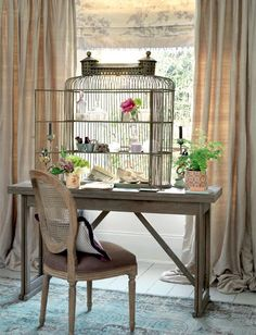 Really a lovely decor. I don't know where to find a large birdcage like that, I'd use it as a paper collector maybe.