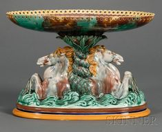 Wedgwood Majolica Figural Compote, England, c. 1871, the oval dish with pierced rim supported atop reeds above the entwined tails of two sea horses, impressed mark, ht. 8 1/2 in.  |  SOLD $711