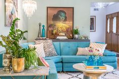 Mid Century Boho Living Room! Love this room! From the Tretchikoff print to the vintage sectional! Wall color, Teresa Green by Farrow and Ball. Photo by Jessica Giesey