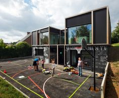 Belgian house incorporates passive house strategies and has fun playground area with giant chalkboard!