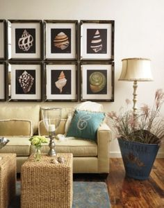Frame shell art in a living room or family space for a nautical look but not tacky. Decorating with sea shells.      Framed art, beach island nautical tropical decor, lamp, rattan table, rug, pillow, monogram, vase, interior decorating