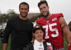 Colin Kaepernick & Alex Boone with a fan. 49ers