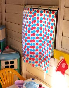 Plastic shower curtain cut to fit hung on a dowel with cup hooks playhouse cubby house maintenance