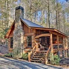 Northern Georgia's Blue Ridge Mountains play host to a cozy cabin in the woods. A large stone chimney anchors one end of the gable design, which also includes an extended porch roof across the front. Resting on stone piers, the raised porch features b Small Log Homes, Log Cabin Homes, Small Log Cabin Plans, Log Cabin Living, Log Cabin House Plans, Small Luxury Homes, Tiny House Cabin, Tiny Cabins, Cabins And Cottages