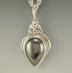 Sterling Silver Pendant with a 21 mm Hematite Pear shape Cabochon. I love hermatite 😍 Silver Jewelry Box, Silver Pendant Necklace, Silver Hoop Earrings, Metal Jewelry, Silver Necklaces, Sterling Silver Pendants, Pendant Jewelry, Gemstone Jewelry, Silver Ring