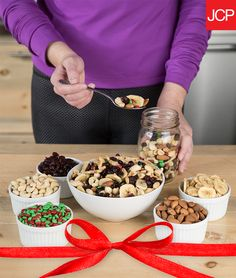 A good trail mix recipe is the perfect pairing for the outdoorsy. So when they're on the move, keep their trails happy with a protein-packed jar of deliciousness! Our favorite recipe sticks to the essentials: raisins, dried bananas, almonds, cashews, and a festive dash of red and green M&M's.