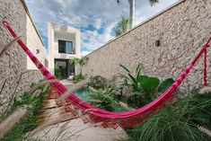 Casa Picasso: Cheerful Holiday Home in Yucatan Makes Most of Limited Space Pool Shapes, Small Terrace, Relaxing Holidays, House Viewing, Narrow House, Wooden Staircases, Mexican Artists, Wooden Decks, Indoor Outdoor