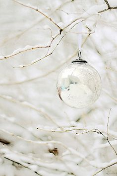 Really nice look of clear ball ornaments outside on tree esp. if it has been snowing.