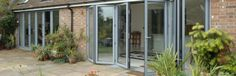 Unique slide and fold dual hollow aluminium system. The doors which sit in a rebated frame have an external curved shape with internal beading. Bottom wheels and top glider are safely concealed within a dedicated floating mullion with the door leafs being joined by a butt type knuckle hinge. Suitable for domestic and light / medium / heavy duty commercial applications.