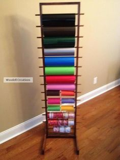 The Cricut vinyl rack my husband and I made. It is made out of wood and provides storage for 14 rolls of vinyl or some tulle and ribbon.  I love it and it was cheap too!