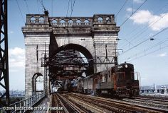 A Fairbanks-Morse leads a freight over Hell Gate Bridge. Train show purchase. Fairbanks Morse, Vintage Trains, Railroad Bridge, Railroad Pictures, Railroad Photography, Train Art, Rolling Stock, Vintage Tools, Model Trains