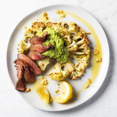 Ingredients:1 Pre Top Sirloin steak patted dry1 head of cauliflowerSpray oil (avocado is preferred because of the high smoke point)Pesto Ingredients:2 1/4 cups fresh or frozen sweet peas (1 10 oz bag frozen peas)1 large garlic c...