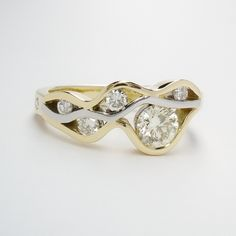 A 6 stone round brilliant cut diamond 'wave' style ring mounted in 18ct. yellow gold and platinum. Wave Ring, Wave Design, Dress Rings, Yellow Gold Rings, Cocktail Rings, Diamond Cuts, Heart Ring, Sapphire, Jewelry Design