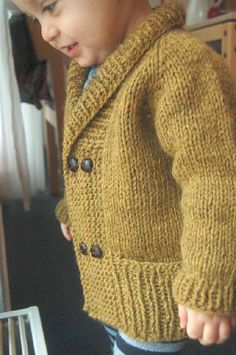 """Cozy yet elegant, comfy and warm, this is the perfect cardigan to snuggle up in at storytime. Just enough ribbing to be distinguished… and just enough garter stitch to be adorable! With subtle worked-in garter stitch elbow """"patches""""… A double-breasted front and cozy shawl collar…. And optional inset pockets hidden behind a wide ribbed hem to stash away treasures…A very fast and easy knit, this cardigan is worked from the top down seamlessly. The body is worked flat; the sleeves are worked…"""