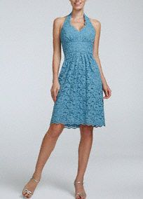 This feminine lace dress exudes timeless beauty and classic charm!  Halter all over lace bodice has a defined waist that helps create a stunning silhouette.  Scalloped lace hem that hits right above the knee.  Fully lined. Back zip. Imported polyester. Dry clean only.  To protect your dress, try our Non Woven Garment Bag.